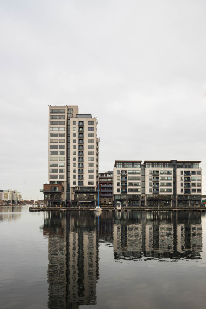 View of Millenium Tower from across the Grand Canal Dock in Dublin