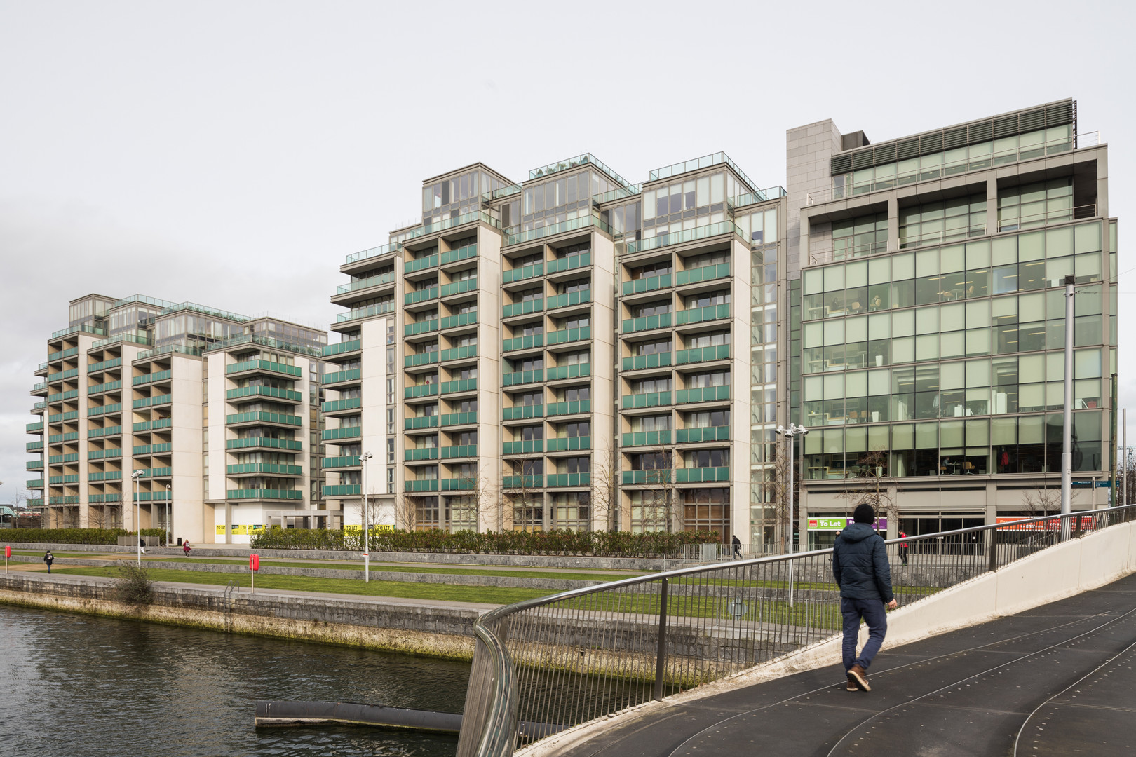 External view of the Spencer Dock Apartments in Dublin from bridge in Linear Park