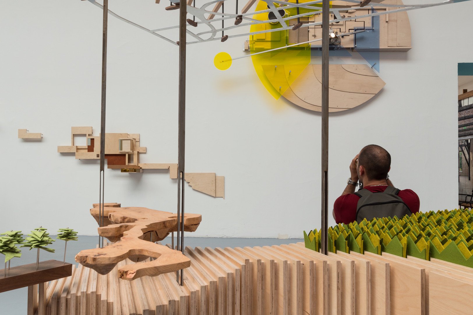 Man sitting on bench as part of pavilion by Bucholz McEvoy Architects at the Venice Biennale 2018