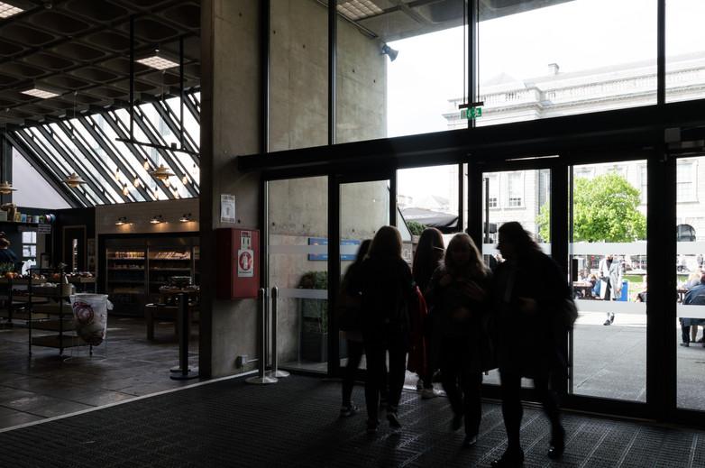 Interior of students entering Arts Block entrance at Trinity College, Dublin