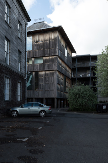 The oak clad Samuel Beckett Theatre in Trinity College, Dublin, viewed from a car park.