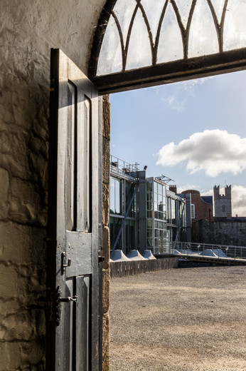 View through door of courtyard and glazed visitor centre of King John's Castle, Limerick