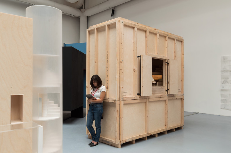 Woman leaning against pavilion designed by Carr Cotter & Naessens at the Venice Biennale 2018