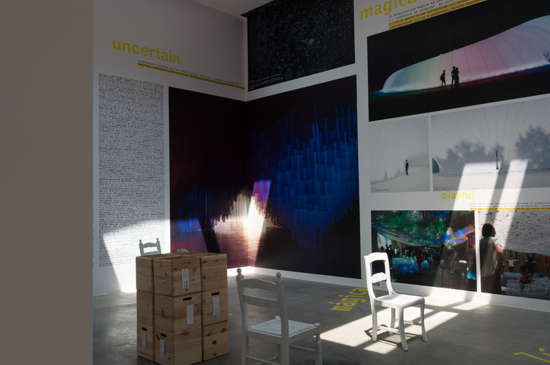 Chair caught in shaft of light of interior of Spanish pavilion at the Venice Biennale 2018