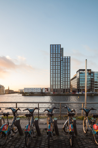 View of Capital Dock from across the Liffey in Dublin with bicycles in foreground