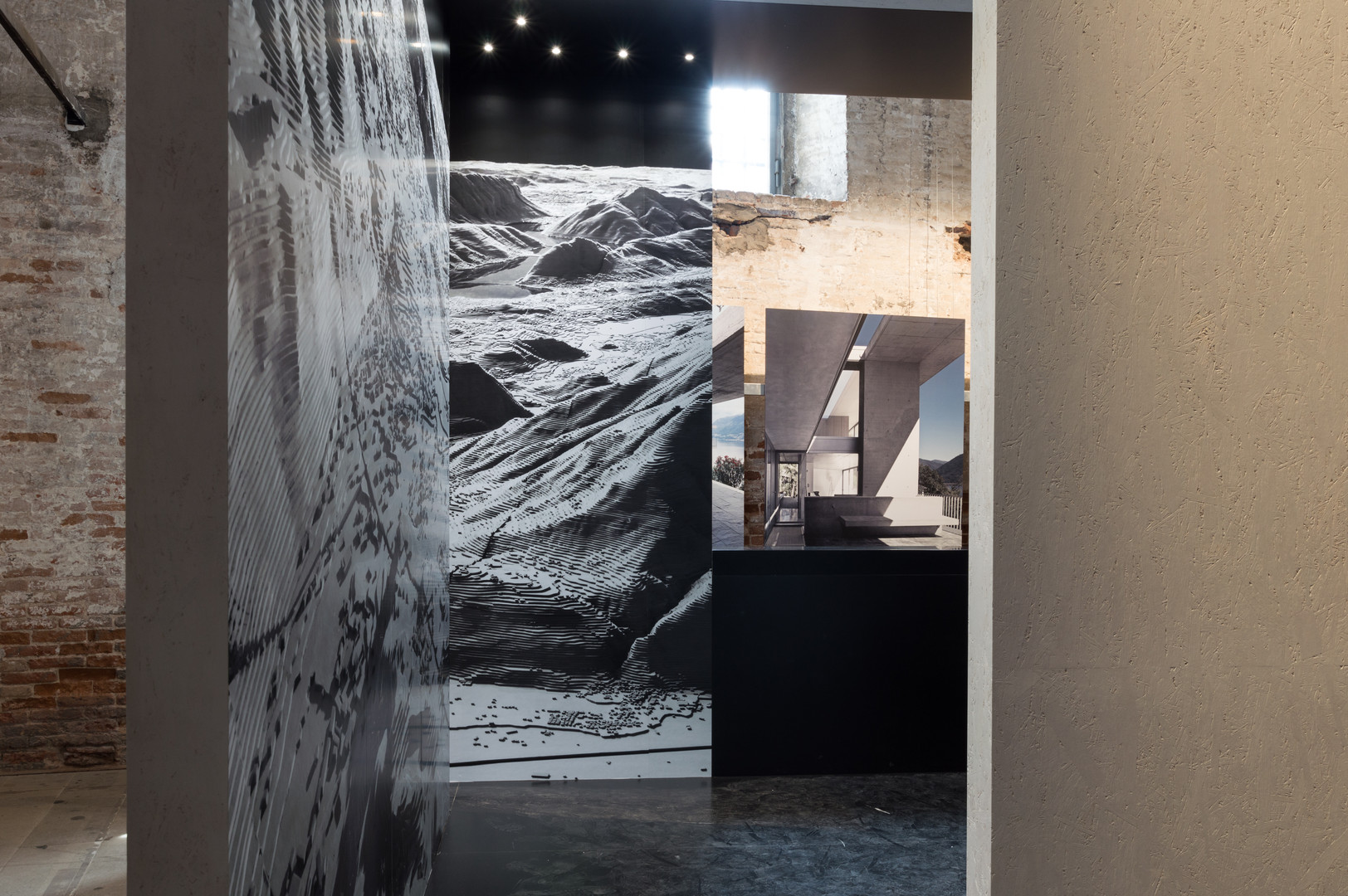 Topographical images as part of the pavilion designed by Mario Botta Architetti at the Venice Biennale 2018