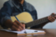 composer-holding-pencil-writing-lyrics-p