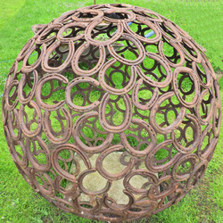 Sphere made from recycled horse shoes
