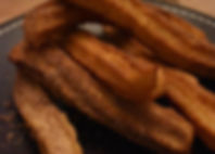 Churros on brown plate.jpg