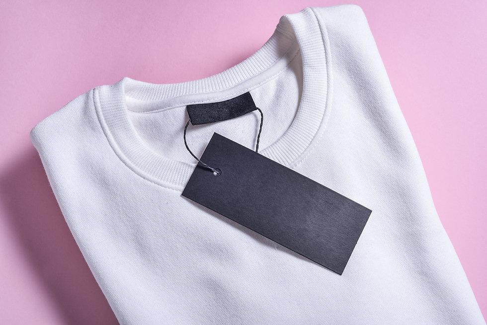 black-label-of-sweatshirt-on-pink-surfac