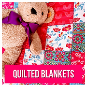 Floral quilted blanket with teddy bear