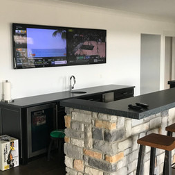 Double TVs over Bar