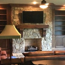 TV Over Mantle on Stone Fireplace