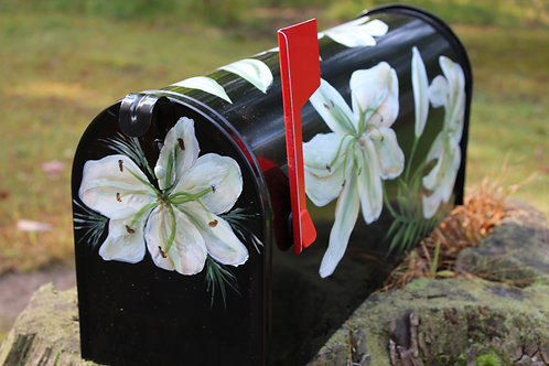BLACK MAILBOX WITH WHITE LILLIES