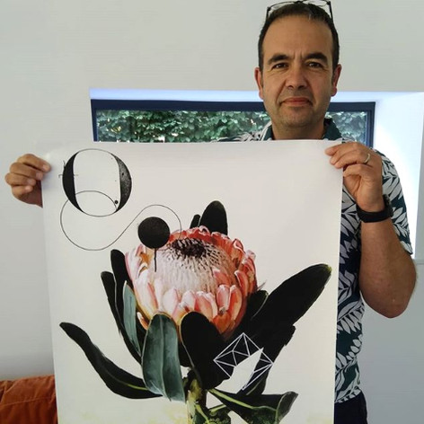 Sam and his new print of the print featuring a 'Protea' flower