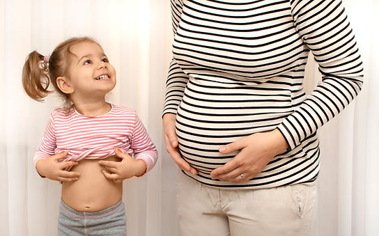 Pregnant woman with first daughter child