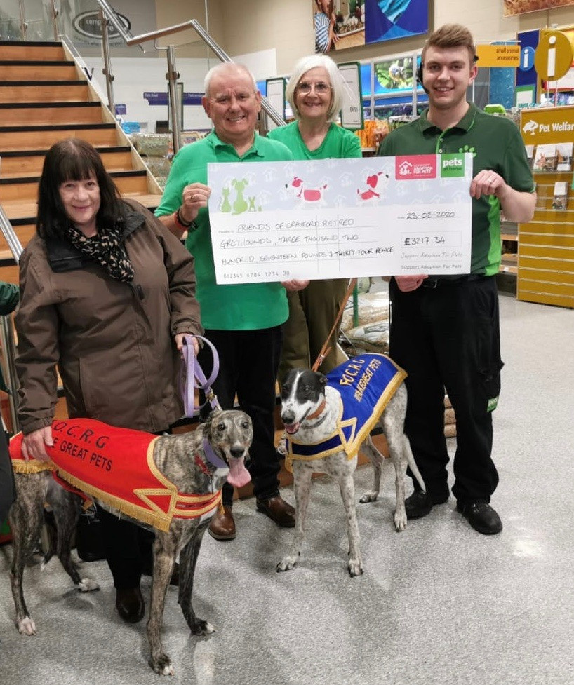 Receiving a cheque from Pets at Home - Crayford