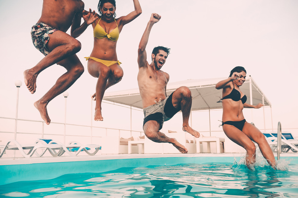 People jumping to pool