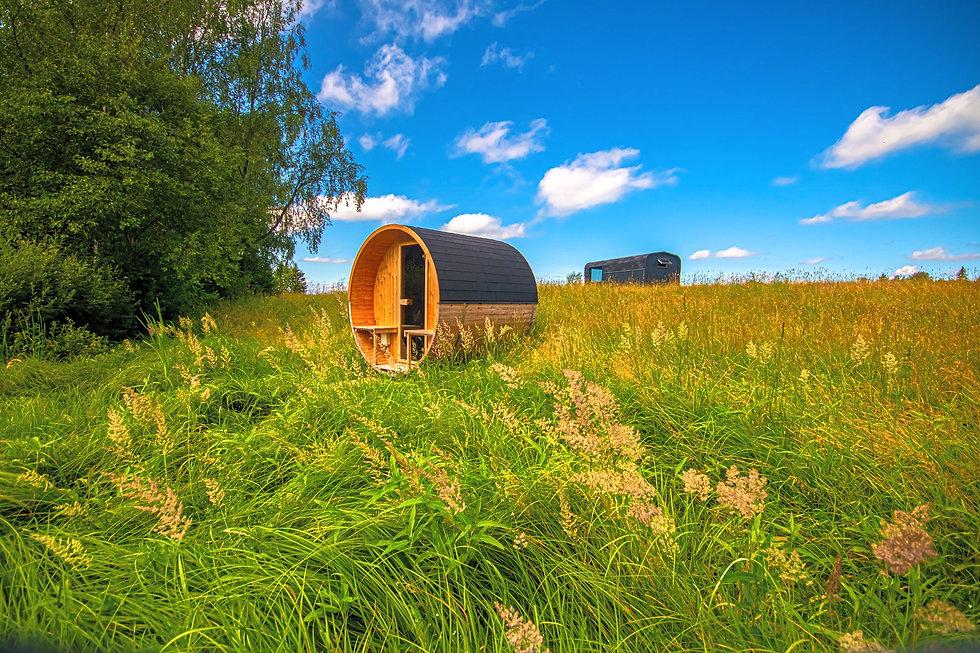 VMS-Timber-barrel-sauna-with-terrace-nature-summer.jpg