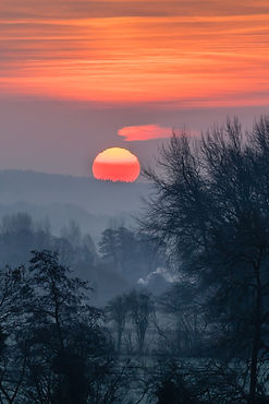 Misty sunrise by David Bull CBE, Hay CC