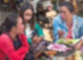 Three women eating a meal outside