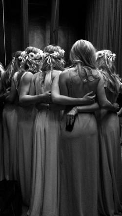 girls hugging fashion show