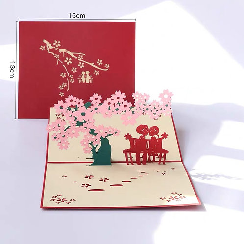 Date under cherry blossom tree pop up card