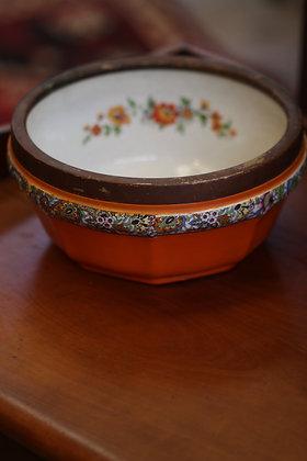 Orange stoneware bowl