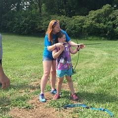 Camper participating in archery