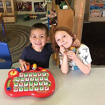 Two kids playing in child care