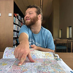 Man pointing to a map in the library
