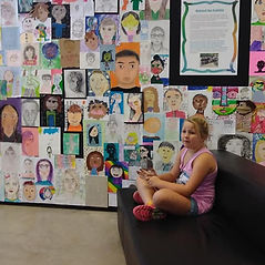 Girl in a room filled with art