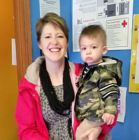 staff member with her child