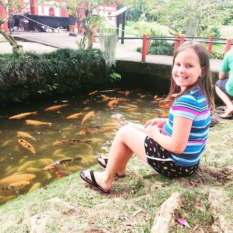 Addison sitting by a pond