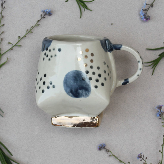 Blue and gold dotted mug