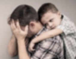 bigstock-Sad-Son-Hugging-His-Dad-119845490-300x200_edited.jpg