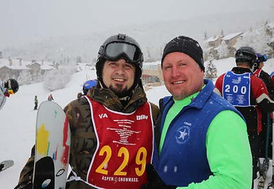 Adam Greathouse standing with instructor