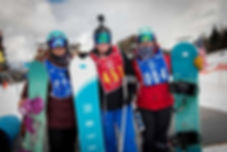 Alica Thompson standing with snowboard