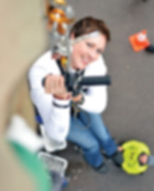 a paraplegic Navy veteran uses adaptive sports equipment to climb a rock wall during the National Disabled Veterans Winter Sports Clinic adaptive sports program