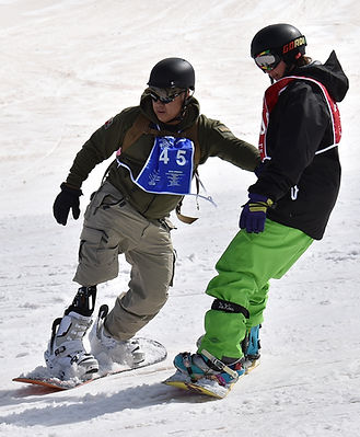 an amputee Army veteran snowboards during the National Disabled Veterans Winter Sports Clinic adaptive sports program