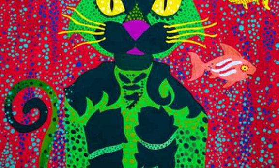 El gato verde en la cima del fondo del mar