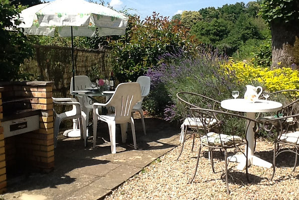 Al fresco dining in the tranquil garden of the farmhouse