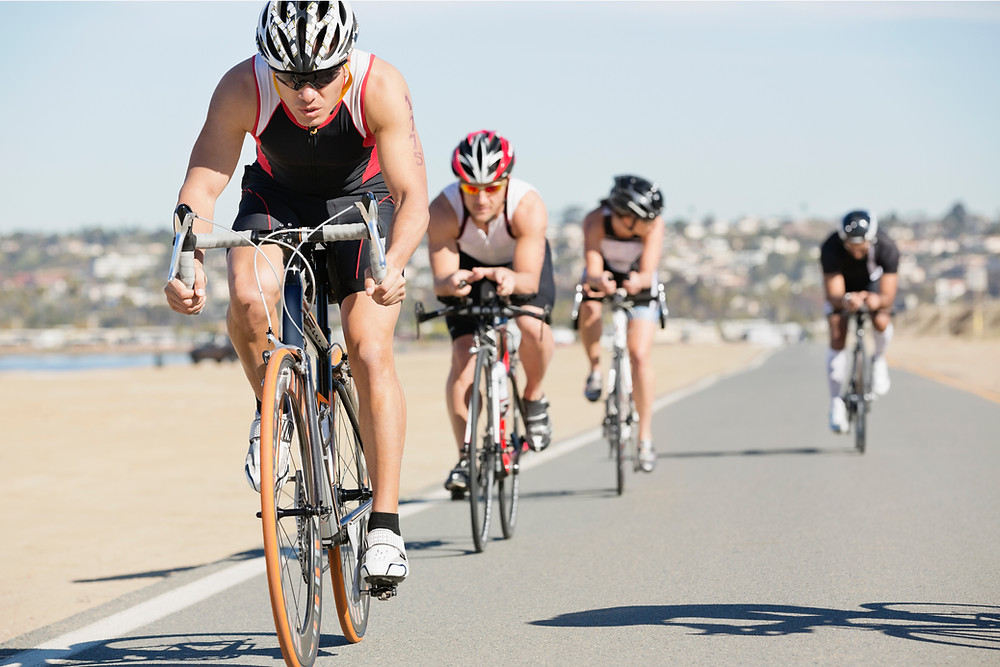 a group of cyclists competing in a triathlon