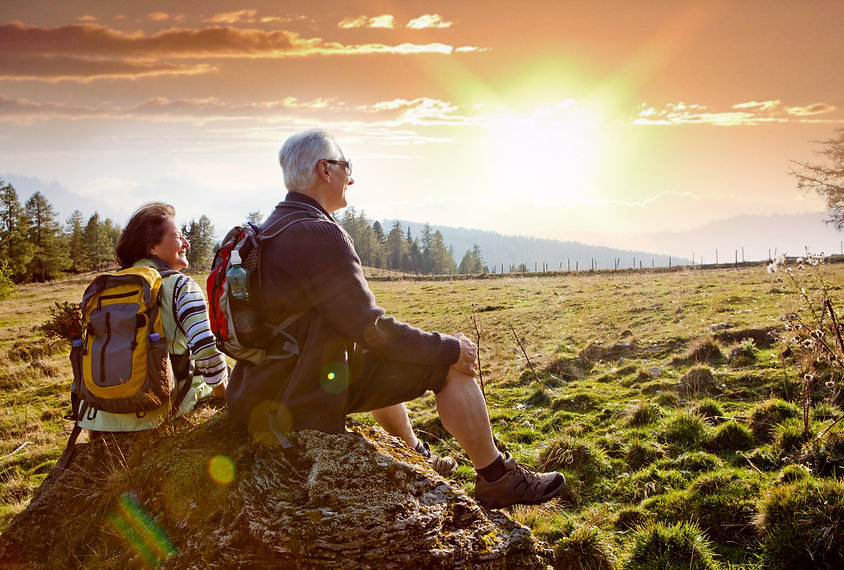 seniors hiking in nature on an autumn da