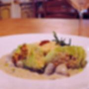 Cabbage, lentils and bulgur rolls with mushroom cream