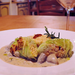 Cabbage, lentils and bulgur rolls with mushroom cream