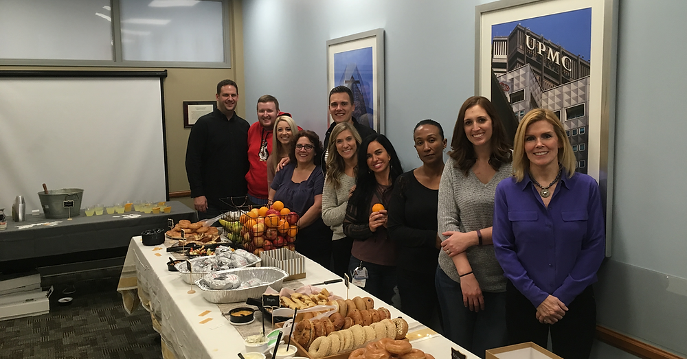 UPMC employees pose with breakfast provided by Hill City Church