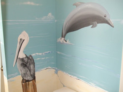 Pelican and dolphin