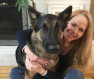 female veterinarian with german shephard dog
