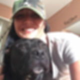 Woman wearing a hat with a pit bull dog